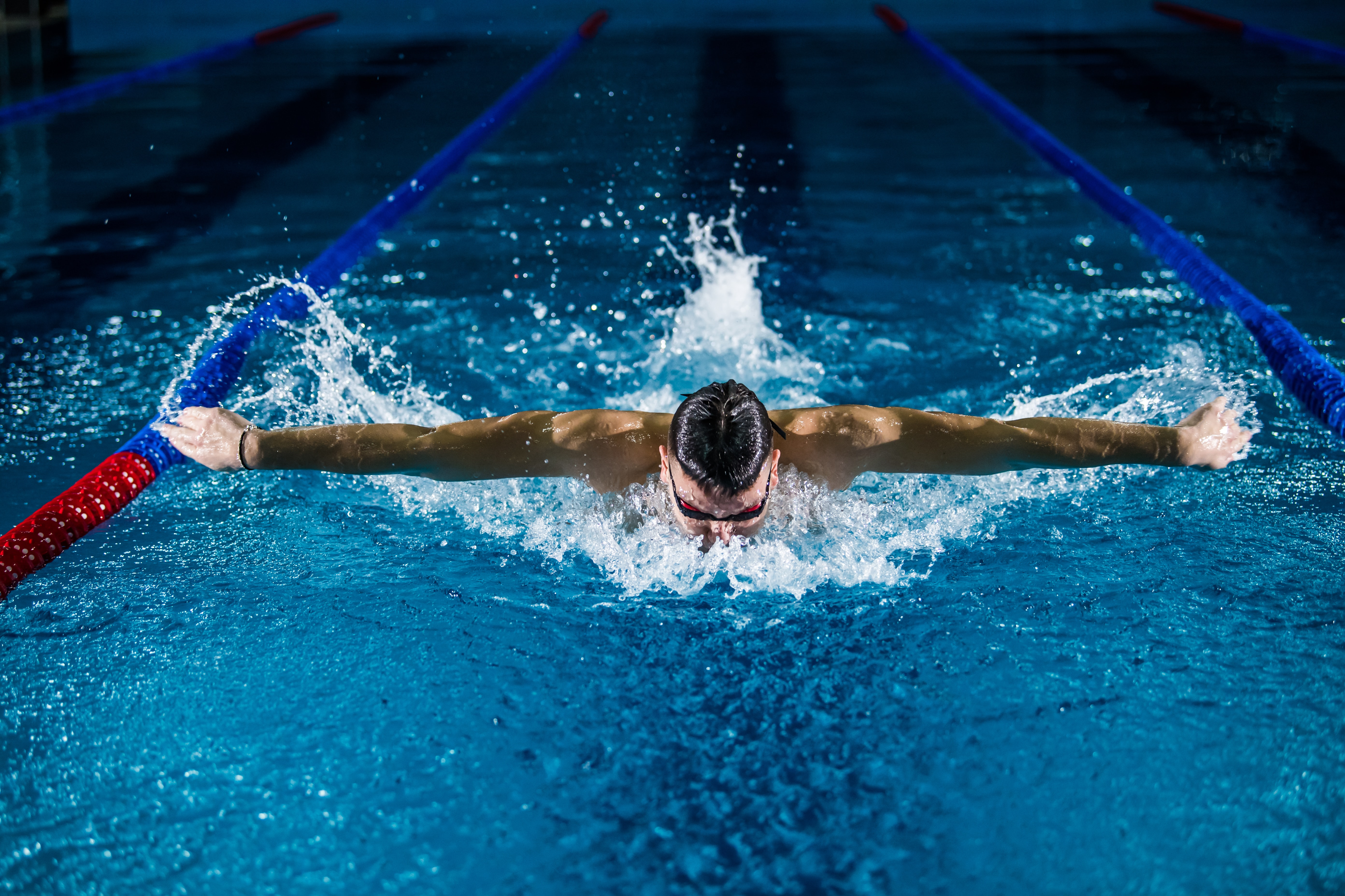 a professional swimmer doing butterfly stroke