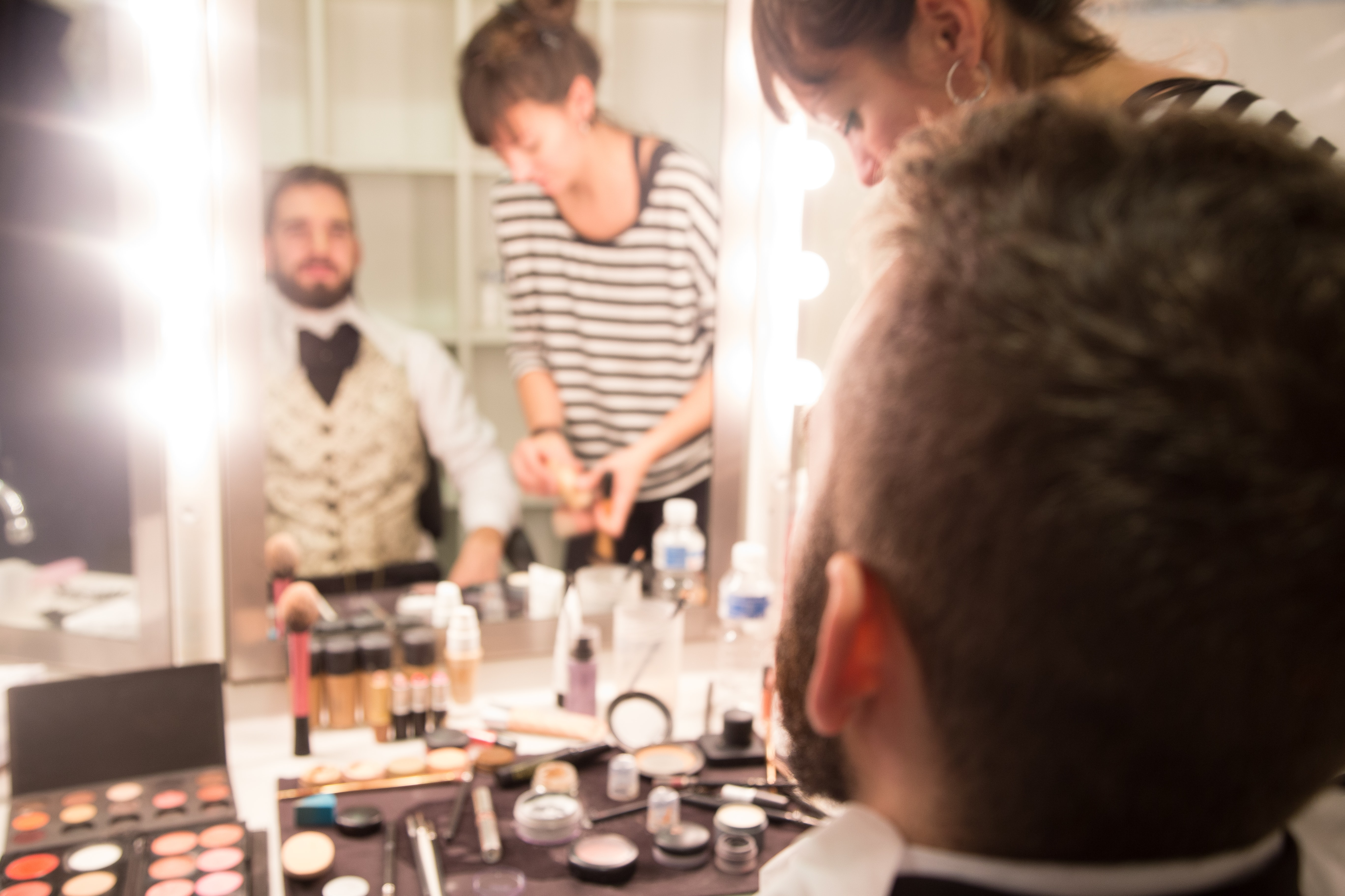 A professional actor in getting makeup applied